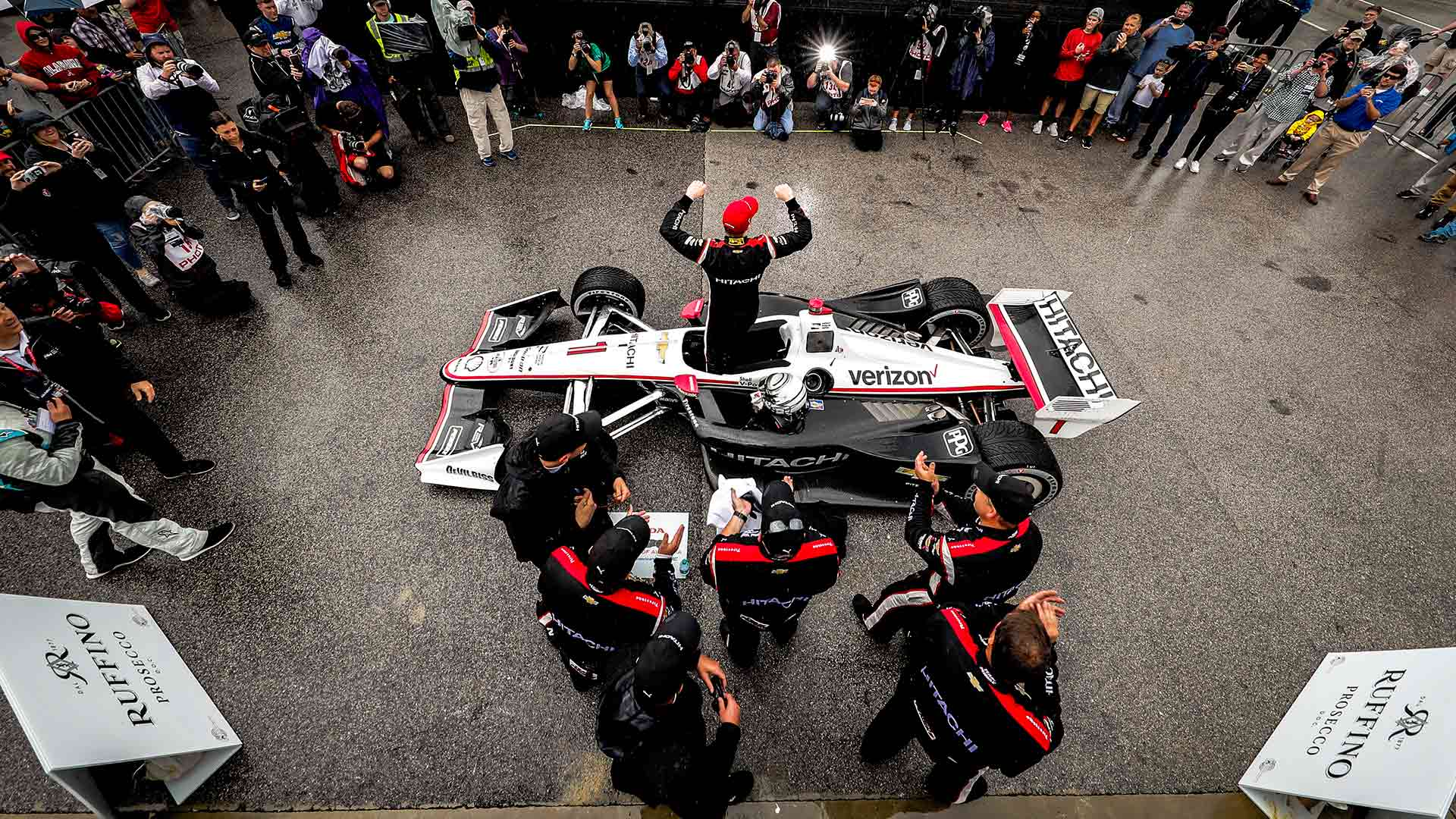 Overhead shot of Josef Newgarden exiting his car in Victory Circle