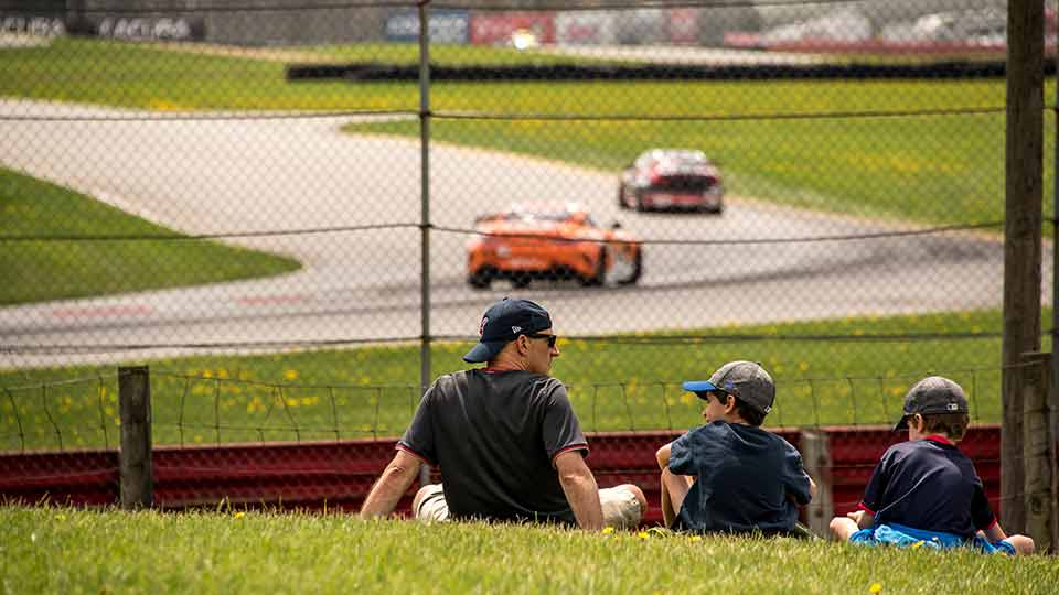 Father and sons enjoying a day at the track