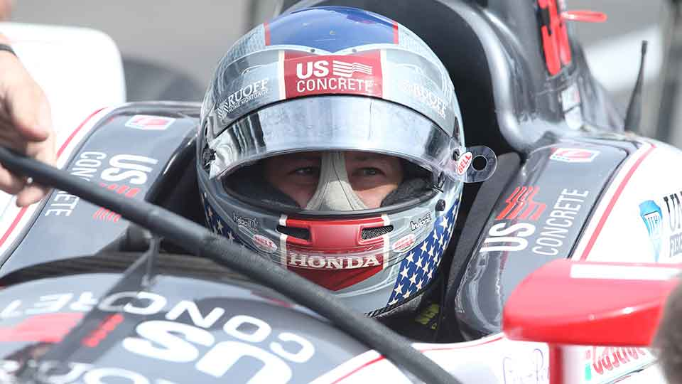 Marco Andretti sits in his 98 car