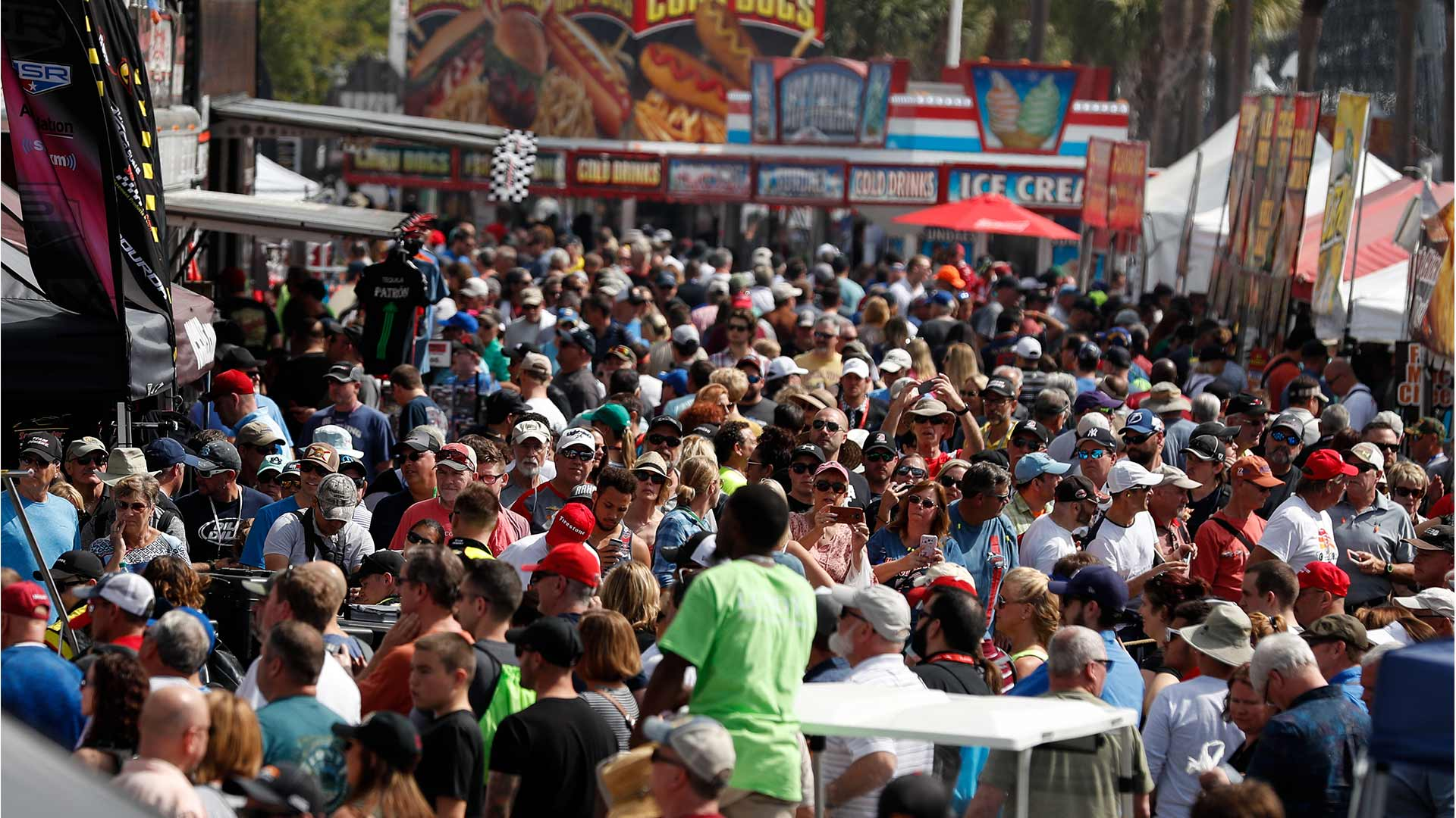 A busy crowd fills the event site