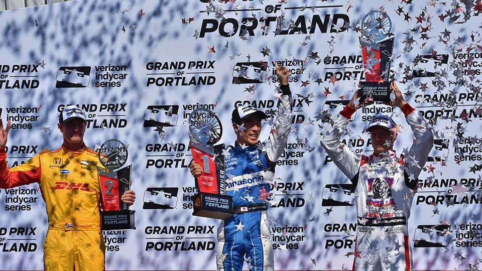Takuma Sato on the podium at the Grand Prix of Portland