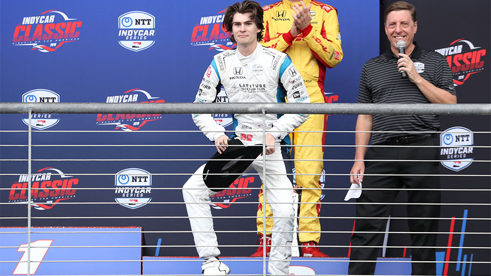 Colton Herta dances on the podium at the Circuit of the Americas