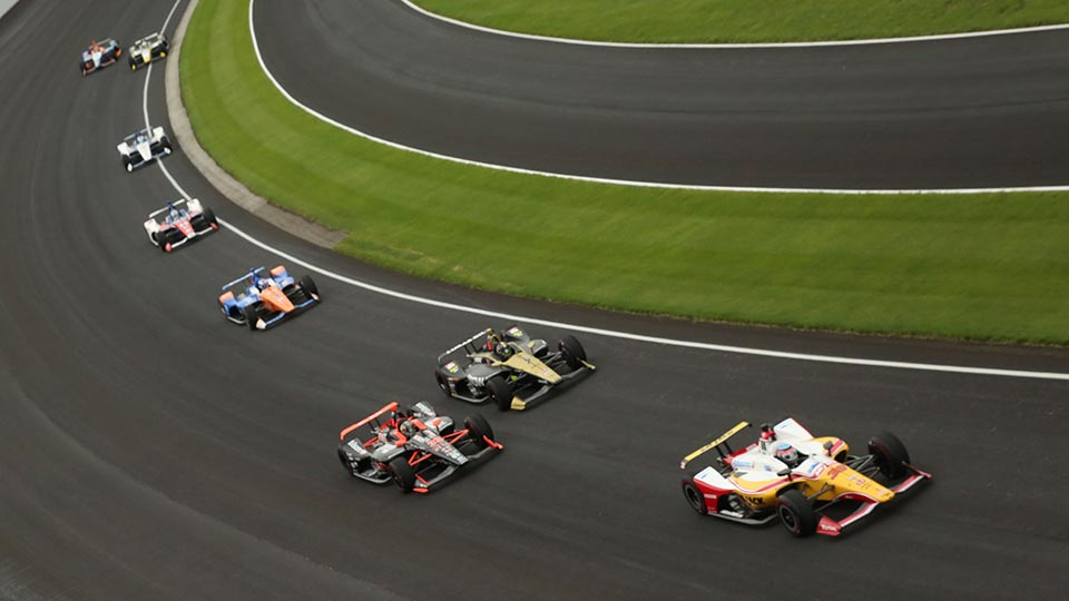 Indy cars race on track