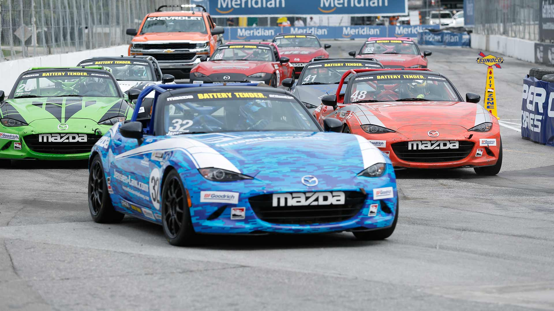Mazda MX-5 Cup cars racing on track